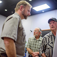 Bob Roland, right, talks with Park Ranger Eric Weaver during a community meeting about ordinance disposal at the El Malpais visitors center in Grants Wednesday.