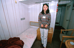 CHINA SICHUAN PROVINCE WANXIAN MAY99 - A Chinese maid poses for a photograph aboard a passenger ferry sailing down the Yangtse river.  jre/Photo by Jiri Rezac
