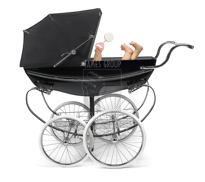 Profile of traditional baby stroller/perambulator with baby arm and feet