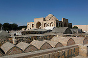 General view of Memorial of Baha Ad-Din Naqshband,  Bukhara, Uzbekistan, pictured on July 12, 2010 in the afternoon. The Memorial complex of Baha Ad-Din Naqshband, 1317-89, patron of Bukhara, and founder of a Sufi order was construct over five centuries, 14th - 19th centuries. It is in a peaceful location 12 kilometres outside Bukhara. In the background is the 16th century Abd Al-Aziz-Khanaka. Bukhara, a city on the Silk Route is about 2500 years old. Its long history is displayed both through the impressive monuments and the overall town planning and architecture. Picture by Manuel Cohen.