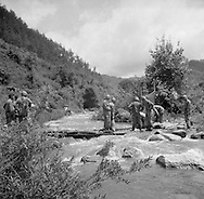 During a break from Korean War fighting members of the U.S. Army, Second Infantry Division do laundry in a river. These are photos of the 2nd Infantry Division in the Korean War in 1950 or 1951.