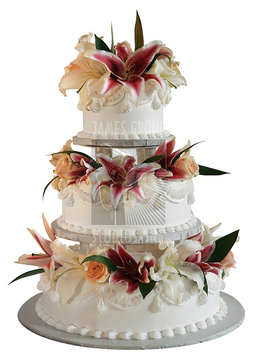 Three layer wedding cake decorated with clowers