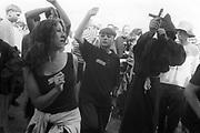 Young male raver enjoying the tunes in the sunlight, Ashton Court Festival, Bristol, UK, 1995.
