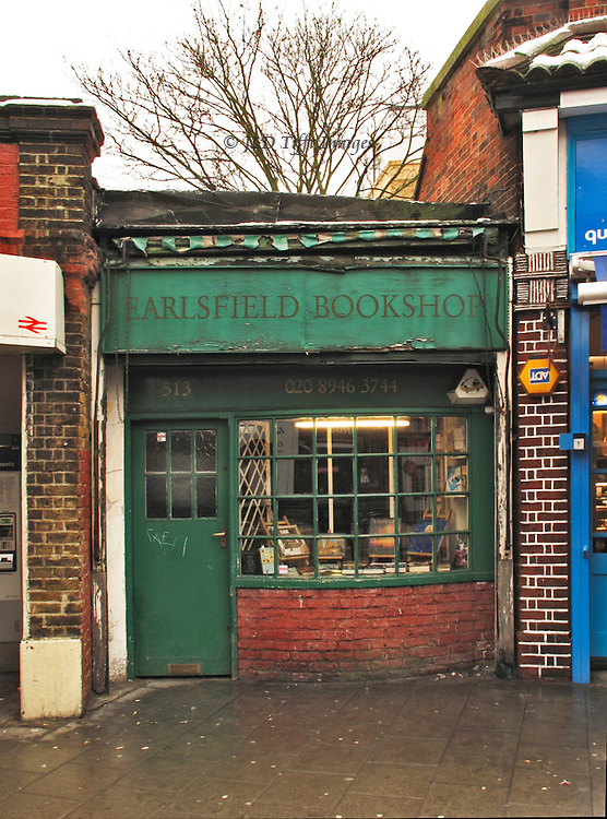 Street facade of the Earlsfield Bookshop, a tiny place with a curving bay window.  It is tucked into a corner of the railway station.  British Rail, (logo visible at left) owns the structure, which is expected to disappear when the old Earlsfield station is updated and modernized,