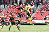 February 12, 2017: Western Sydney Wanderers defender Jonathan ASPROPOTAMITIS (22) goes up for the ball with Central Coast Mariners forward Roy O'DONOVAN (9) at Round 19 of the 2017 Hyundai A-League match, between Western Sydney Wanderers and Central Coast Mariners played at Spotless Stadium in Sydney.