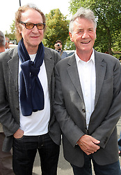 Ray Davies  and Michael Palin at the unveiling of a  blue plaque dedicated to former Monty Python Graham Chapman at his local pub the Angel in Highgate, North London, Thursday, 6th September 2012  Photo by: Stephen Lock / i-Images