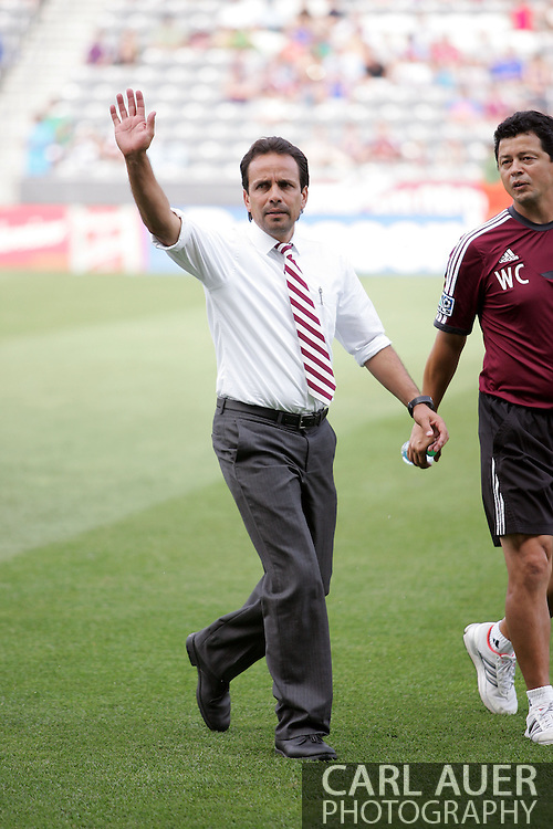 July 27th, 2013 - Colorado Rapids head coach Oscar Pareja waves to the fans as he comes onto the field prior to the start of action in the Major League Soccer match between the LA Galaxy and the Colorado Rapids at Dick's Sporting Goods Park in Commerce City, CO