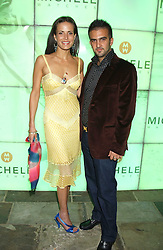 Model SOPHIE ANDERTON and MR MARK ALEXIOU at Michele Watches Kaleidoscope Summer Garden Party held at Home House, Portman Square, London on 15th June 2005.<br />