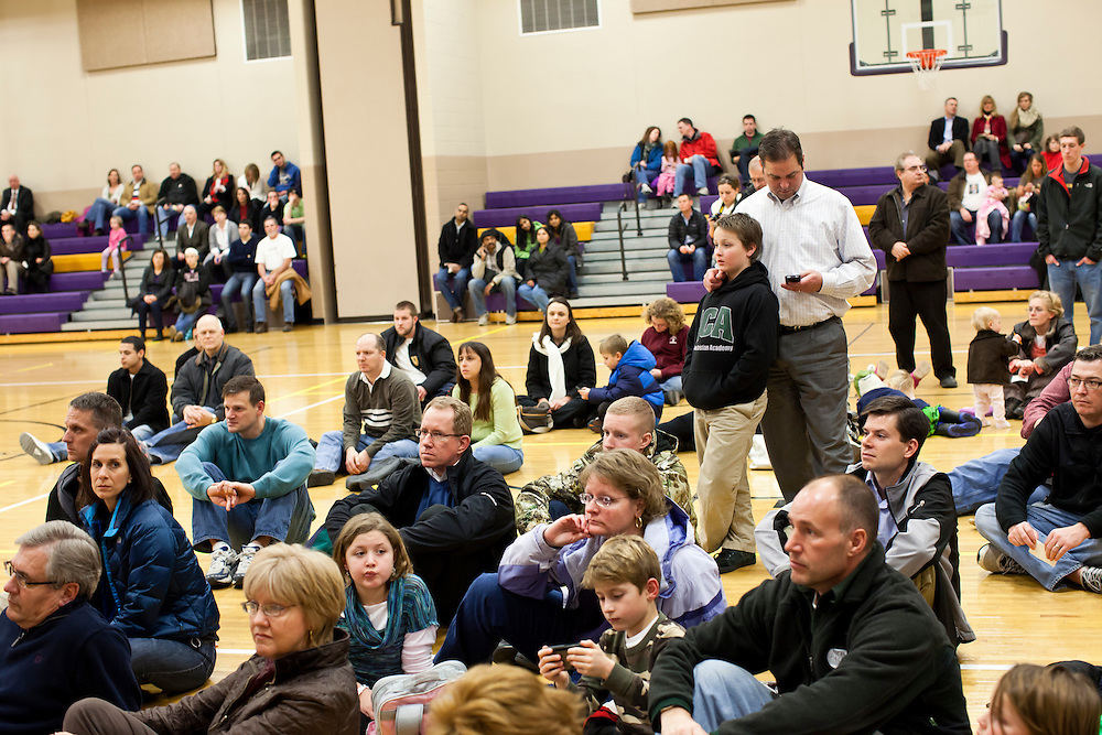 People listen to speakers at a caucus site at Summit Middle School on Tuesday, January 3, 2012 in Johnston, IA.