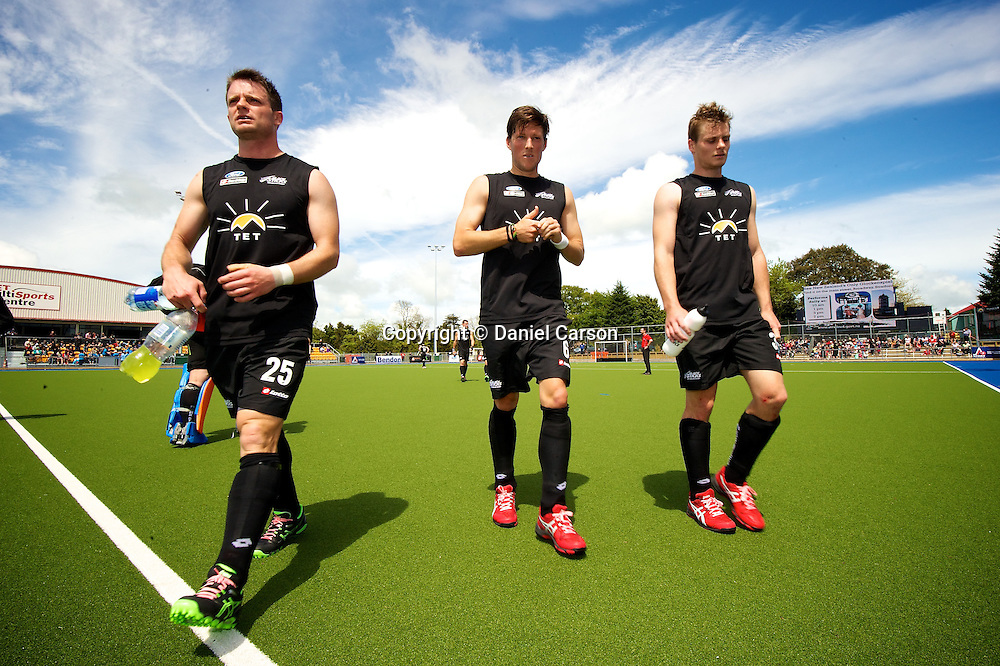 Shea Mcaleese, Simon Child and Steven Edwards of the New Zealand Black Sticks come back onto the pitch at half time during the match from the Oceania Cup Hockey - Kookaburras v Black Sticks Men, 1 November 2013. Photo: Daniel Carson | DCIMAGES.ORG   | photosport.co.nz