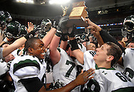 26 Nov. 2011 -- ST. LOUIS -- Football players from Staley High School, including Morgan Steward (89, his normal 36 was destroyed during the game), Zacaria Blakemore (78) ad Jason Kat (88) celebrate with the trophy for winning the MSHSAA Class 5 state title over Kirkwood High School at the Edward Jones Dome in St. Louis Saturday, Nov. 26, 2011. Photo © copyright 2011 Sid Hastings.
