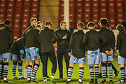 Forest Green Rovers head coach, Mark Cooper gives a pre-match talk during the EFL Trophy match between Walsall and Forest Green Rovers at the Banks's Stadium, Walsall, England on 12 November 2019.