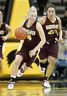 25 JANUARY 2007: Minnesota guard Emily Fox (4) drives down court in Iowa's 80-78 overtime loss to Minnesota at Carver-Hawkeye Arena in Iowa City, Iowa on January 25, 2007.