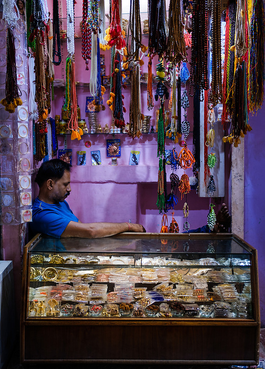 VARANASI, INDIA - CIRCA NOVEMBER 2016: Merchant in the streets of Old Varanasi.