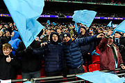 Manchester City fans celebrate the goal scored by David Silva (21) of Manchester City to give a 3-0 lead during the EFL Cup Final match between Arsenal and Manchester City at Wembley Stadium, London, England on 25 February 2018. Picture by Graham Hunt.