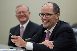 U.S. Department of Labor secretary Thomas Perez, right, sits with Larry Roberts, Secretary of Labor, Kentucky, during a round table discussion. <br /> <br /> U.S. Department of Labor secretary Thomas Perez made a visit to Louisville, Wednesday, Nov. 20, 2013. <br /> <br /> While in Louisville he visited the Ford Motor Company Louisville Assembly Plant, Kentucky Manufacturing Career Center and Office Environment Company for tours and round table discussions. <br /> <br /> The secretary visited with elected officials, company officials, community business leaders, students, and employees. Secretary of Labor Thomas Perez  visits the Ford Motor Company Louisville Assembly Plant (LAP), touring the vehicle assembly area, holding a roundtable discussion with Ford and UAW officials