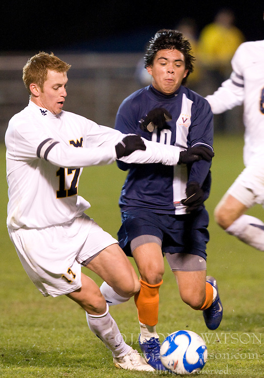 Virginia midfielder Jonathan Villanueva (10) collides with West Virginia defender Andrew Halsell (17).  The West Virginia Mountaineers defeated the Virginia Cavaliers 1-0 in the second round of the 2007 NCAA Men's Soccer Tournament at Dick Dlesk Stadium in Morgantown, WV on November 28, 2007.