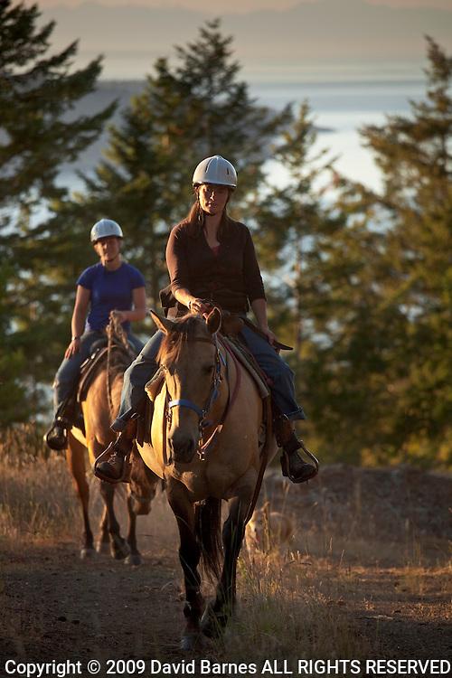 Woman horseback riding, Orcas Island, San Juan Islands, Washington, USA