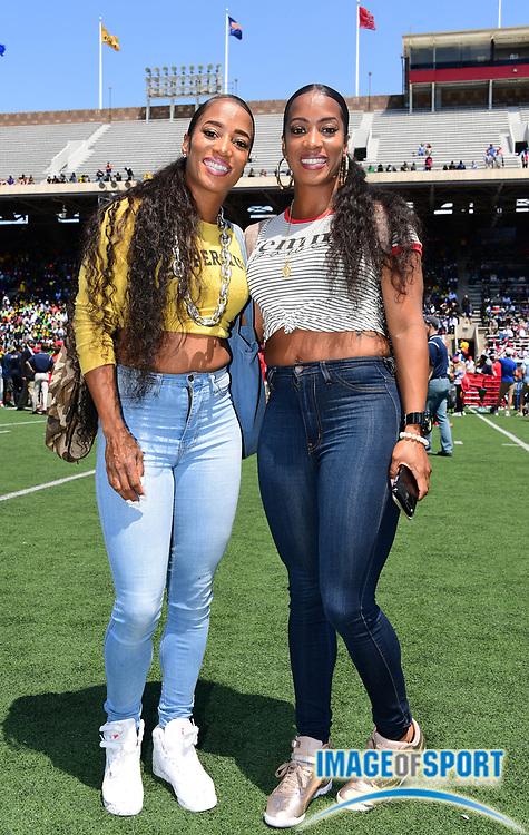 Apr 28, 2018; Philadelphia, PA, USA; Twin sisters Miki Barker aka Mikele Barber (left) and Lisa Barber aka Me'Lisa Barber pose during the 124th Penn Relays at Franklin Field.