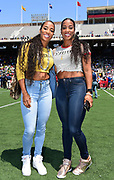 Apr 28, 2018; Philadelphia, PA, USA; Twin sisters Miki Barker aka Mikele Barber (left) and Lisa Barber aka Me'Lisa Barber pose during the 124th Penn Relays at Franklin Field.