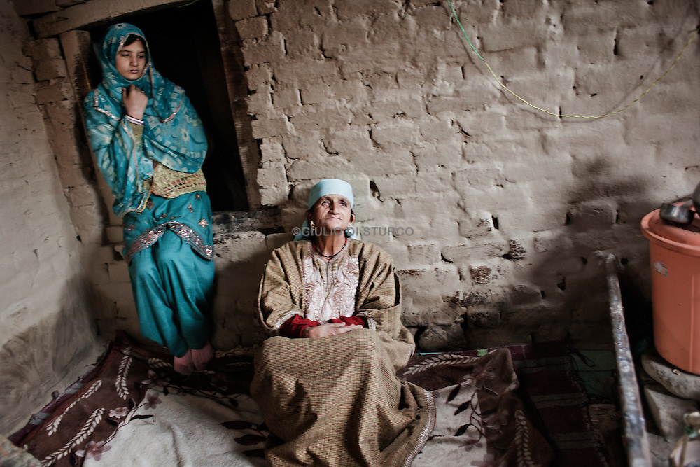 Misra ( 50  Half Widows),.Gulam Rasool Malek is her husband has disappered in 1992, when he was 40 years old. Pattan, Kashmir 2011.
