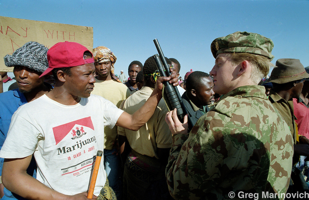 Boipatong, Vaal, Transvaal, South Africa 1992, June. ANC supporters confront police in the aftermath of President FW de Klerks visit several days after the killing of 41 people by Inkatha warriors said to be supported by police.