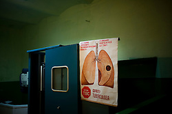 An X-Ray machine and poster about TB in a prison in Chisinau urges inmates to get x-rays in time in ordr to prevent tb.