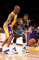 06 November 2009: Guard OJ Mayo of the Memphis Grizzles passes the ball while being defended by Kobe Bryant of the Los Angeles Lakers during the first half of the Lakers 114-98 victory over the Grizzles at the STAPLES Center in Los Angeles, CA.