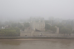 © Licensed to London News Pictures. 24/09/2013. London, UK. The Tower of London is seen enveloped in fog this morning (24/09/2013) in London. Photo credit: Matt Cetti-Roberts/LNP