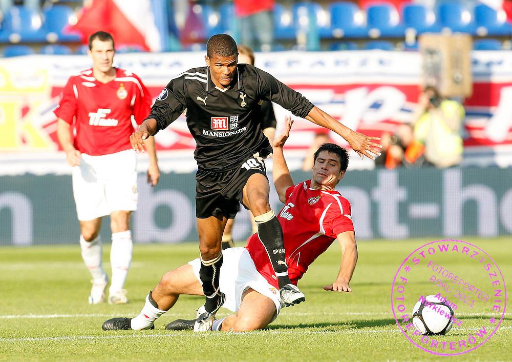 Fraizer Campbell of Tottenham Hotspur is fouled by Mauro Cantoro of Wisla Krakow ...--------------------..Piotr Hawalej ..UEFA Cup - First Round..Second Leg..Wisla Krakow v Tottenham Hotspur..2 October 2008..FOT. PIOTR HAWALEJ / WROFOTO