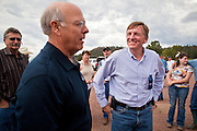10 AUGUST 2011 - ALPINE, AZ:  New Mexico Republican Congressman Steve Pearce (left) and Arizona Republican Congressman Paul Gosar at Luna Lake, near Alpine, AZ, talk to ranchers impacted by the Wallow Fire, which burned through the area earlier this summer. 2011 was the worst year in Arizona's history in terms of acres lost to wild fires and the Wallow Fire was the largest fire in Arizona history. Both Congressmen are advocates of the Tea Party's platform of limited federal government.   PHOTO BY JACK KURTZ