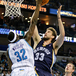 Jan 20, 2010; New Orleans, LA, USA; Memphis Grizzlies center Marc Gasol (33) shoots over New Orleans Hornets forward Julian Wright (32) during the first half at the New Orleans Arena. Mandatory Credit: Derick E. Hingle-US PRESSWIRE