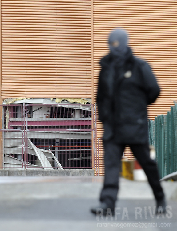 A Basque police member looks for evidences next to the building of Basque journal El Correo, where separatist armed group ETA exploded off a bomb early on June 8, 2008, in the northern Spanish Basque village of Zamudio. No victims were reported.