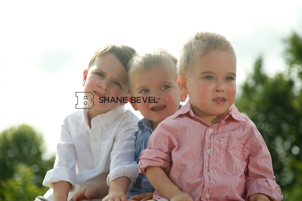 5/28/15 5:40:26 PM -- Miracle Miles and his family pose for portraits and play at the QuikTrip park for the 2015 Saint Francis Health System advertising campaign. <br /> <br /> Photo by Shane Bevel