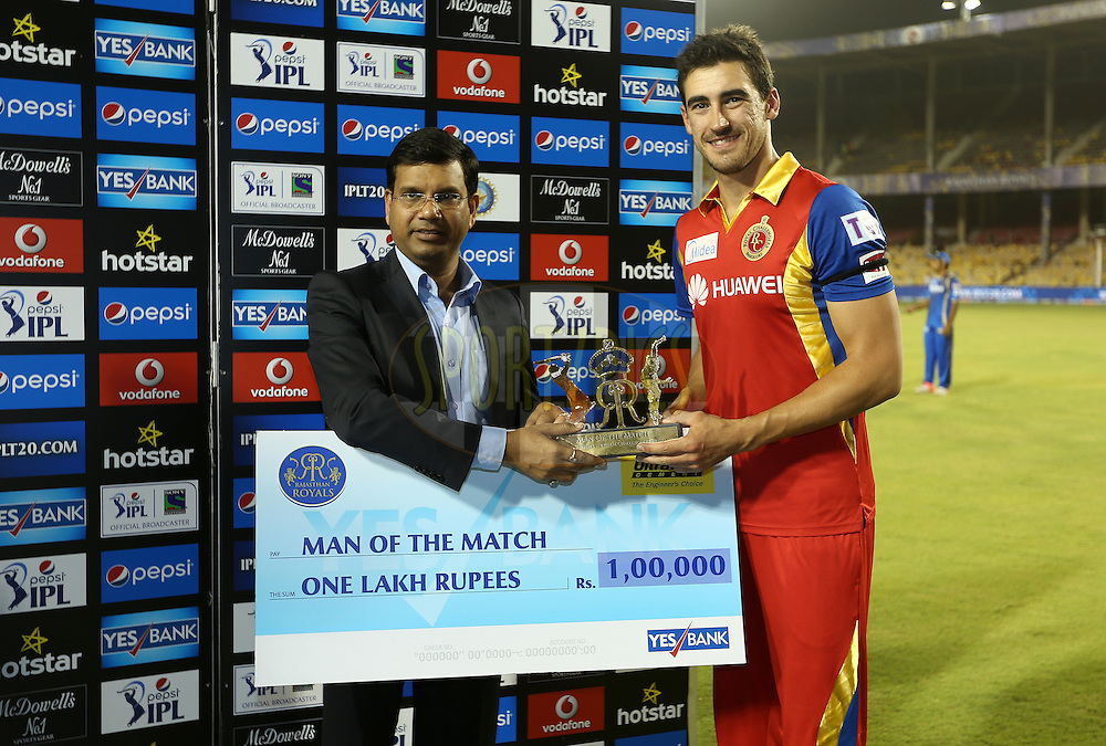 Royal Challengers Bangalore player Mitchell Starc receives the Man of the Match Award during the presentation of the match 22 of the Pepsi IPL 2015 (Indian Premier League) between The Rajasthan Royals and The Royal Challengers Bangalore held at the Sardar Patel Stadium in Ahmedabad , India on the 24th April 2015.<br /> <br /> Photo by:  Sandeep Shetty / SPORTZPICS / IPL