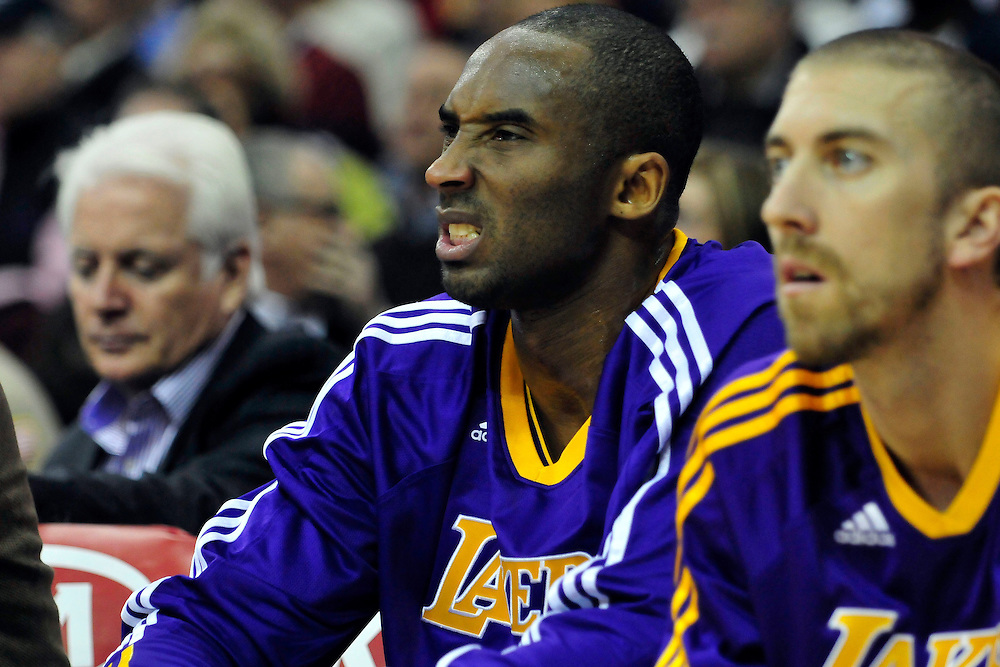 Feb. 16, 2011; Cleveland, OH, USA; Los Angeles Lakers shooting guard Kobe Bryant (24) grimaces from the bench after being charged with a technical foul during the first quarter against the Cleveland Cavaliers at Quicken Loans Arena. Mandatory Credit: Jason Miller-US PRESSWIRE