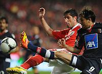 20120331: LISBON, PORTUGAL – Portuguese Liga Zon Sagres 2011/2012 - SL Benfica vs CS Braga.<br />In picture: Benfica's Joan Capdevilla, from Spain, back, fights for the ball with Braga's Mossoro, from Brazil.<br />PHOTO: Alvaro Isidoro/CITYFILES