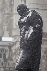 © licensed to London News Pictures. London, UK 18/01/2013. Winston Churchill statue covered with snow as snow hits London on Friday 18, January 2013. Photo credit: Tolga Akmen/LNP