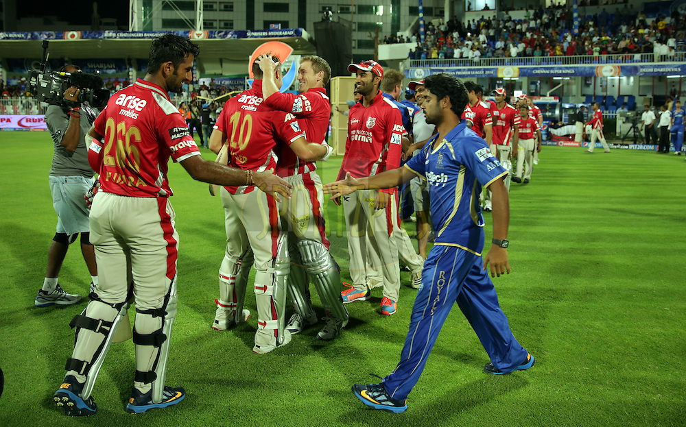 Players of Rajasthan Royals and Kings XI Punjab shakes hand after the  match 7 of the Pepsi Indian Premier League 2014 between the Rajasthan Royals and The Kings XI Punjab held at the Sharjah Cricket Stadium, Sharjah, United Arab Emirates on the 20th April 2014<br /> <br /> Photo by Sandeep Shetty / IPL / SPORTZPICS