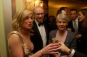 Eva Birthistle, Ken Loach and  Mrs.. 25th  annual Awards of the London critic's Circle in aid of the NSPCC. The Dorchester. Park Lane. London. 9 February 2005. ONE TIME USE ONLY - DO NOT ARCHIVE  © Copyright Photograph by Dafydd Jones 66 Stockwell Park Rd. London SW9 0DA Tel 020 7733 0108 www.dafjones.com