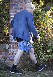 © Licensed to London News Pictures. 01/10/2018. Thame, UK. Boris Johnson returns to his house after buying a newspaper wearing a crumpled jacket over his running shorts. The former foreign secretary is due to attend Conservative Party Conference this week. Photo credit: Peter Macdiarmid/LNP