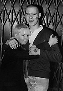 Skinhead Couple, man with tattoo's on his cheek and hand