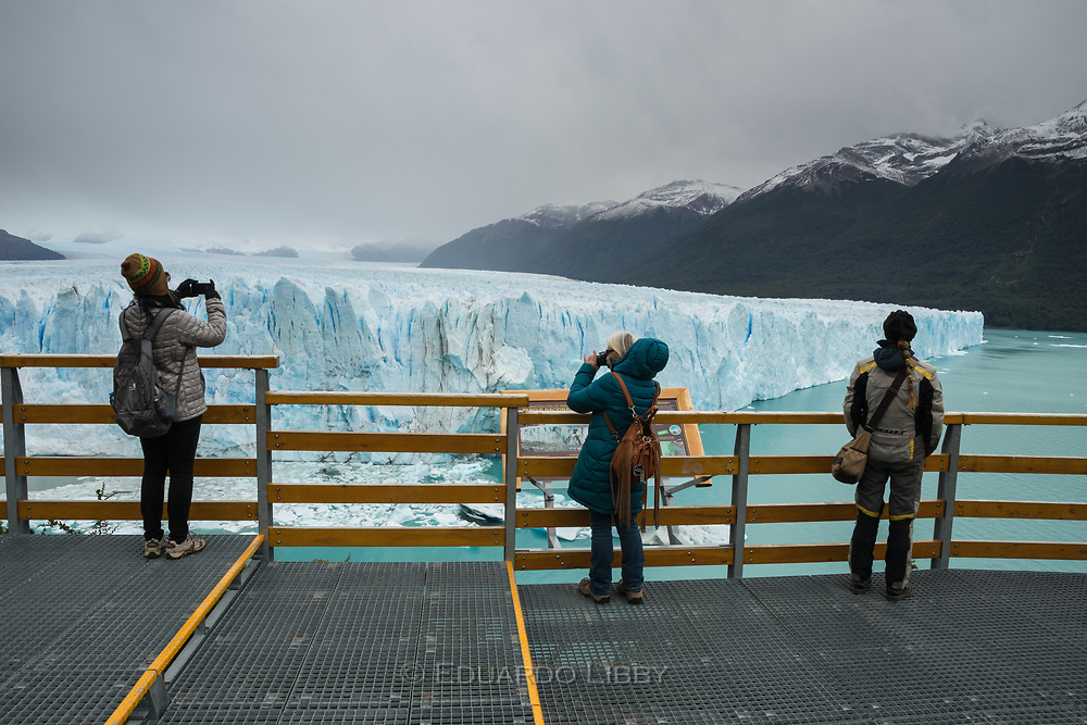 "Tourists in the ""pasarelas."" A steel walkway in front of Perito Moreno Glacier"