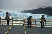 "Tourists in the ""pasarelas."" A steel walkway in front of Perito Moreno Glacier"