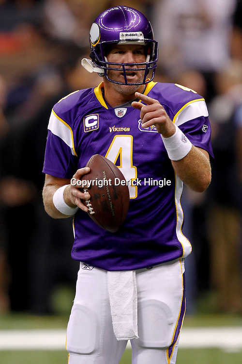 September 9, 2010; New Orleans, LA, USA; Minnesota Vikings quarterback Brett Favre (4) during warm ups prior to kickoff of the NFL Kickoff season opener at the Louisiana Superdome. The New Orleans Saints defeated the Minnesota Vikings 14-9.  Mandatory Credit: Derick E. Hingle