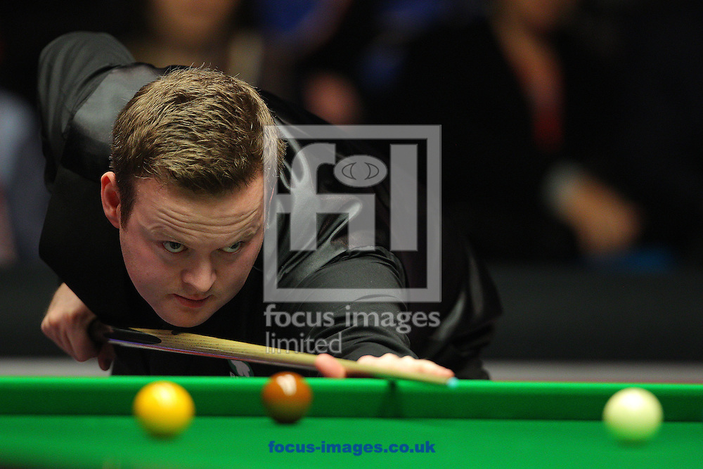 Shaun Murphy plays a shot during the Dafabet Masters final at Alexandra Palace, London<br /> Picture by Paul Terry/Focus Images Ltd +44 7545 642257<br /> 18/01/2015