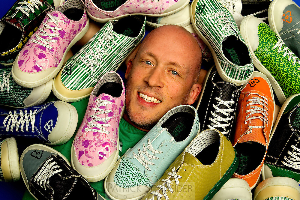 Charlotte small business photography of Gary Gagnon, founder and CEO of Remyxx, a 100 percent recycable sneaker in fashionable design. REMYXX markets itself as the world's first and only completely landfill-free sneakers. The Charlotte-based entrepreneur appeared on ABC television's Shark Tank in May 2012. Gagnon says more than 300 million pairs of shoes were thrown away in the U.S. in 2011.<br /> <br /> Charlotte Photographer - PatrickSchneiderPhoto.com