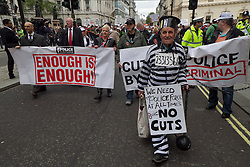 © Licensed to London News Pictures. 10/05/2012. London, UK. A protester dressed as a prisoner joins thousands of off duty Police Officers from around the UK demonstrating in London today (10/05) in protest over proposed changes to Police budgets and pensions. Photo credit : James Gourley/LNP