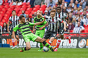 Forest Green's Darren Carter tackles Grimsby Town's Jon Nolan during the Conference Premier Final match between Forest Green Rovers and Grimsby Town FC at Wembley Stadium, London, England on 15 May 2016. Photo by Shane Healey.