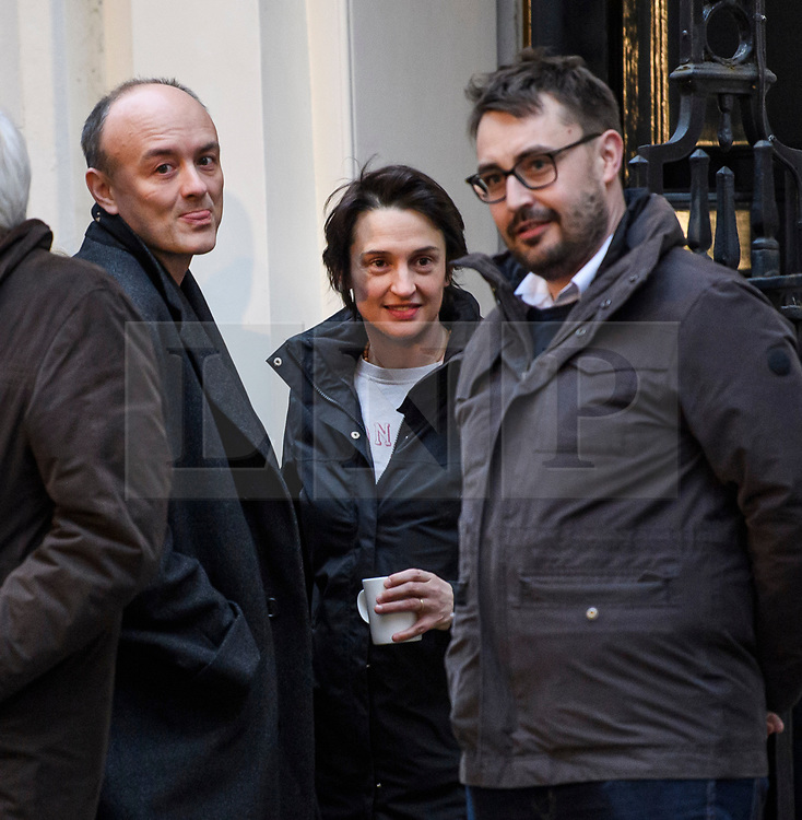 © Licensed to London News Pictures. 13/12/2019. London, UK. DOMINIC CUMMINGS (left), his wife MARY WAKEFIELD (centre) and deputy chief of staff BEN GASCOIGNE, watch British Prime Minister Boris Johnson deliver a speech to edit, on the day the Conservative party achieved a clear majority in the General Election. A general election was called for December 12th following a deadlock in Parliament over the UK's decision to leave the EU. Photo credit: Ben Cawthra/LNP